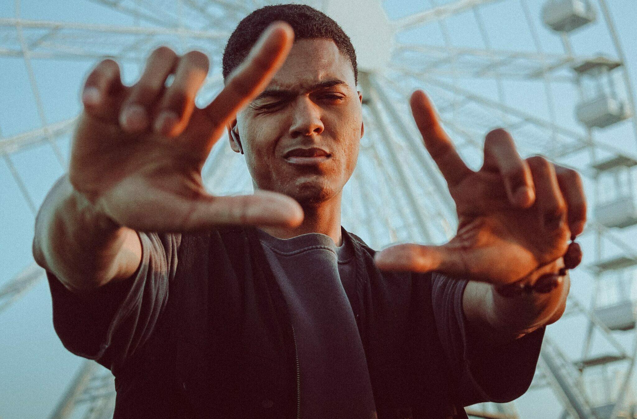 man in black long sleeve shirt raising his hands
